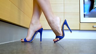 zoom on blue mules in the kitchen. veins. arches. soles
